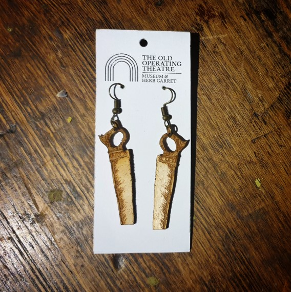 A pair of dangle earrings in the shape of a bone saw from the 19th century