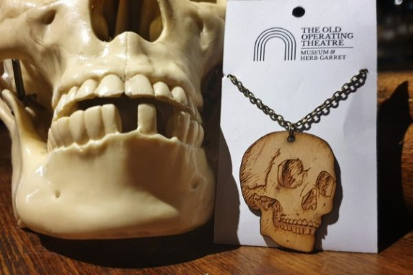 A pendant with a skull that was inspired by our museum's educational skull