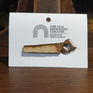 Large bone saw from the 19th century wooden brooch.