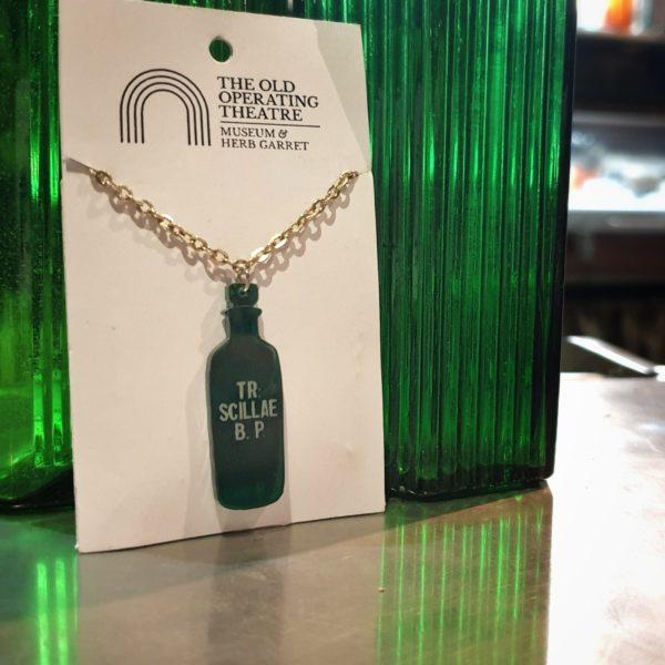 Apothecary bottle pendant of TR. Scillae B.P.
