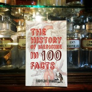 Still life with Caroline Rance's The History of Medicine in 100 Facts